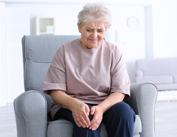 elderly woman holding her knee