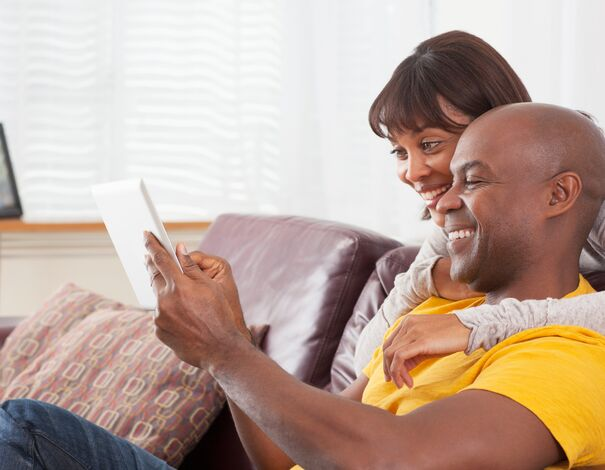 Couple reading about covid-19 (coronavirus) myths on tablet