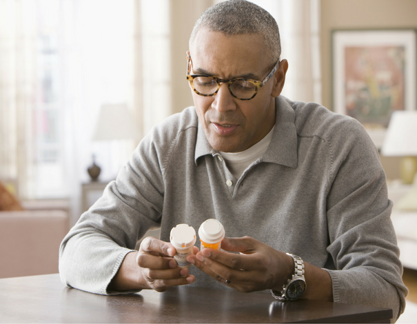Man reading medication labels